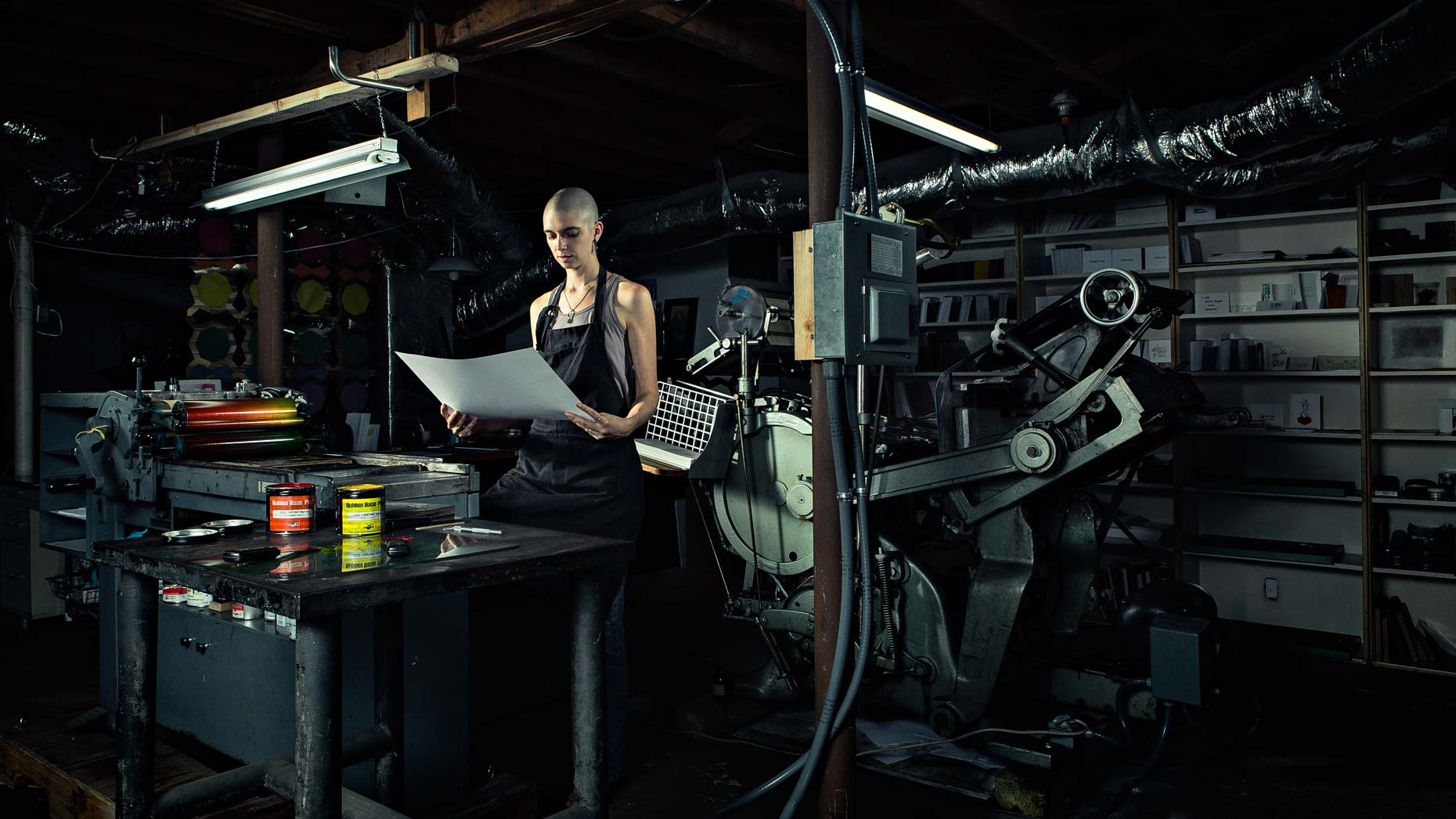 Portrait of letterpress artist examining photography print, by Atlanta photographer