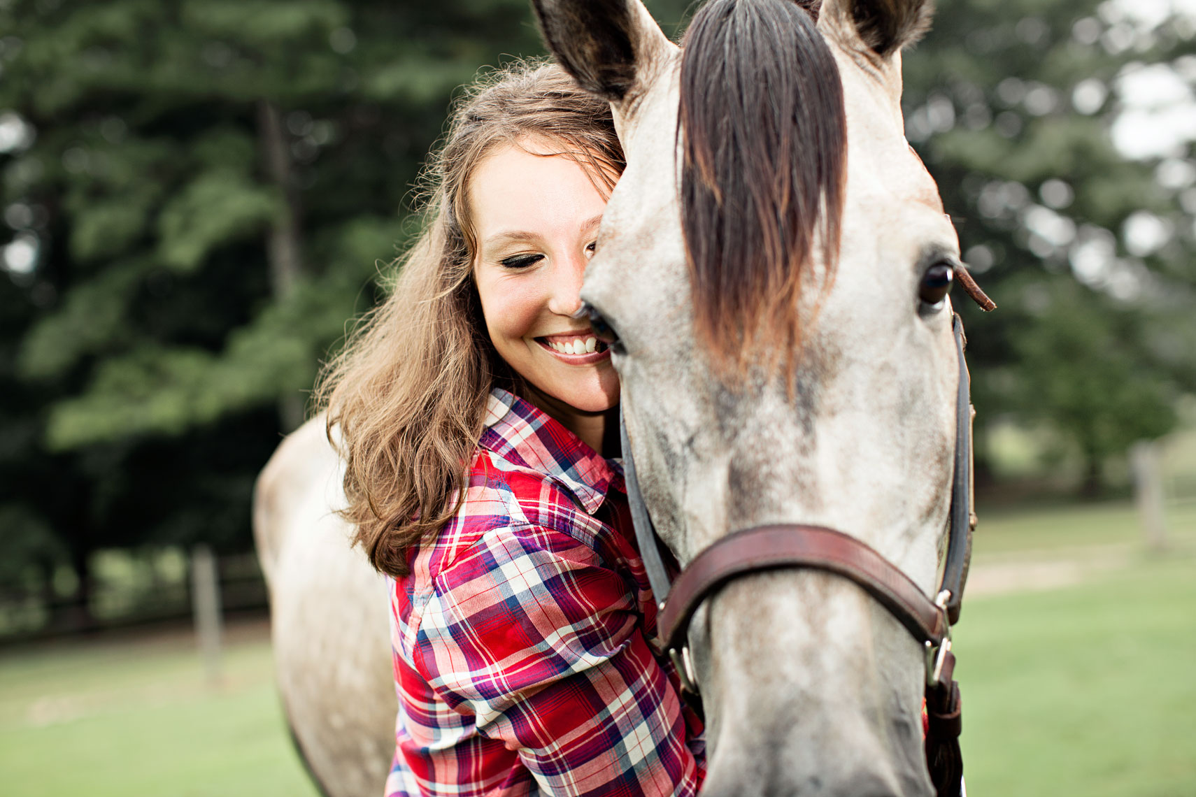 Young woman hugs neck of horse. By Atlanta photographer Nick Burchell