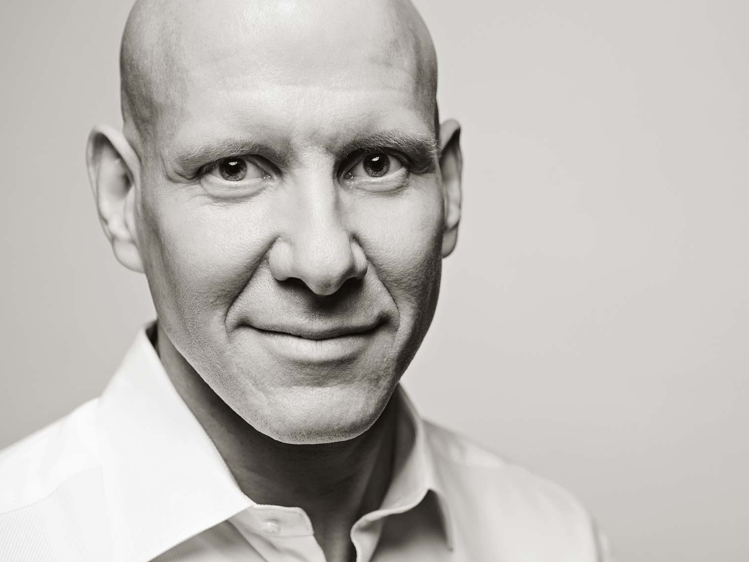 Black and white corporate portrait of bald Atlanta businessman