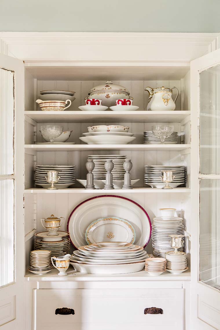 White tableware in country buffet hutch by Atlanta photographer