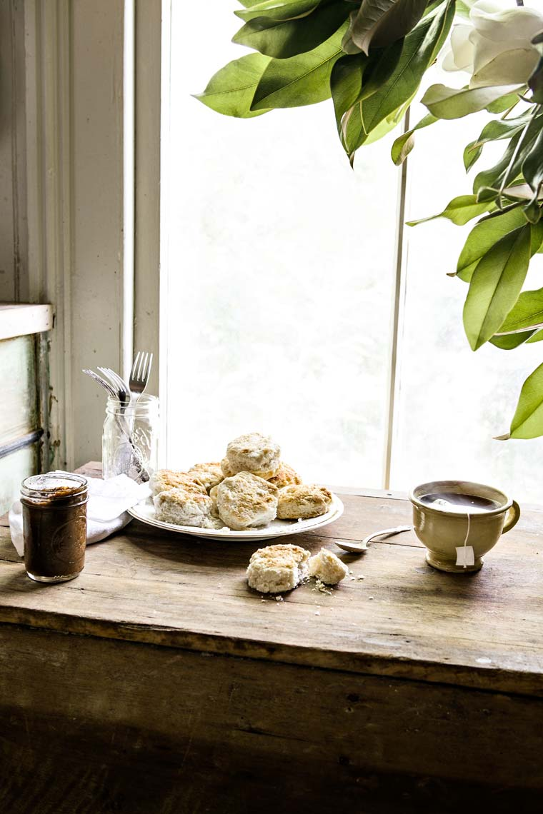 Scones and tea on table by window showing interior design,  Atlanta