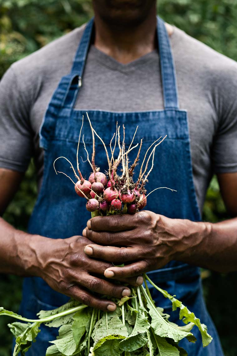 tight portrait of african american male holding vegetables by Atlanta based lifestyle photographer