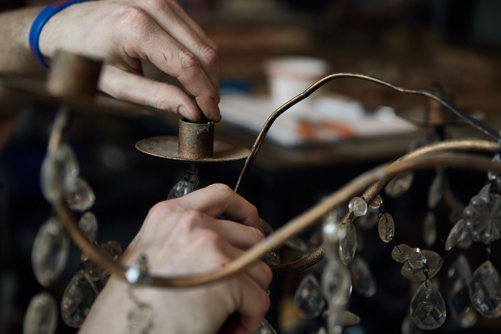 Craftsman repairs antique chandelier in Atlanta, Nick Burchell photographer