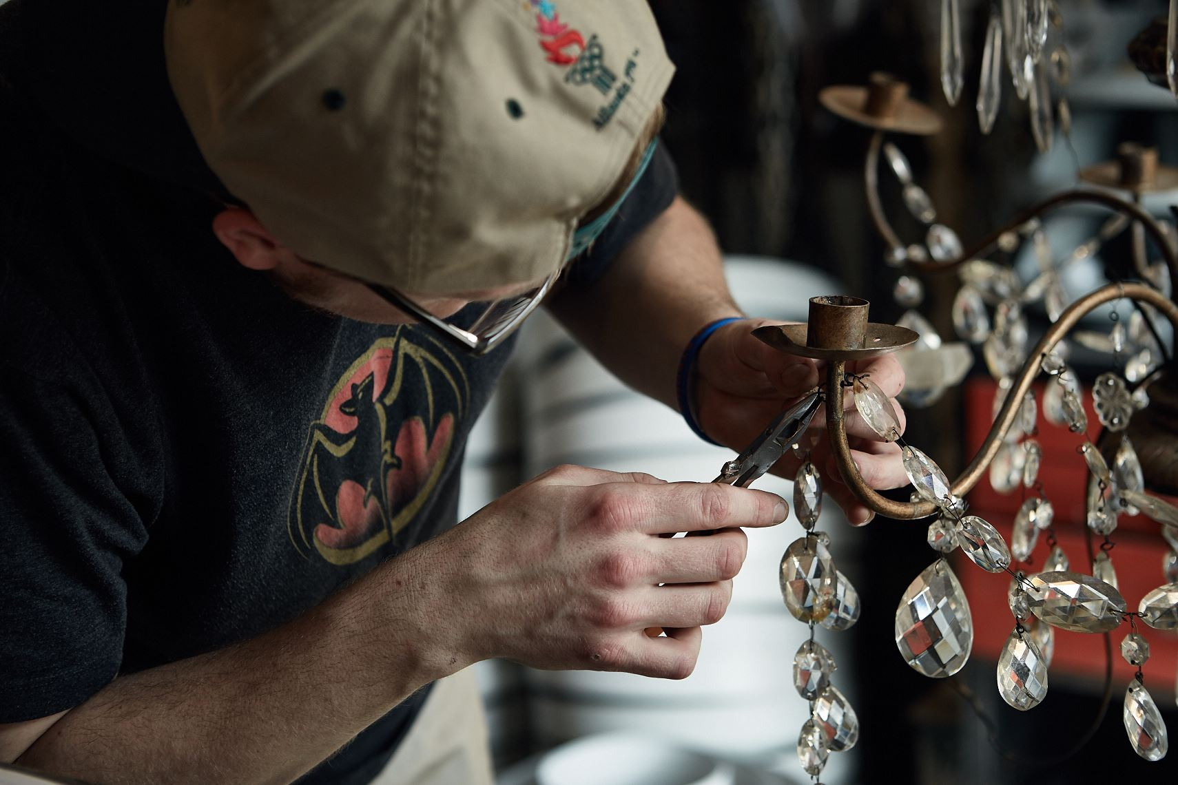 Craftsman repairs antique chandelier, Atlanta. Photographer Nick Burchell