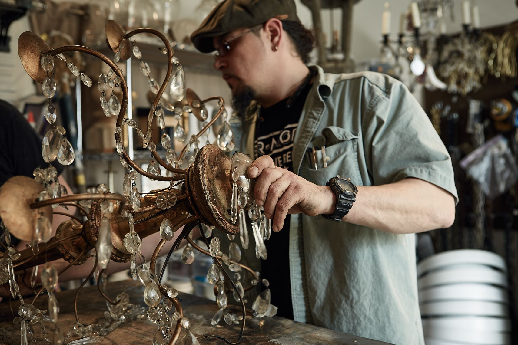 Michael Morales repairs antique chandelier, Atlanta, Nick Burchell photography