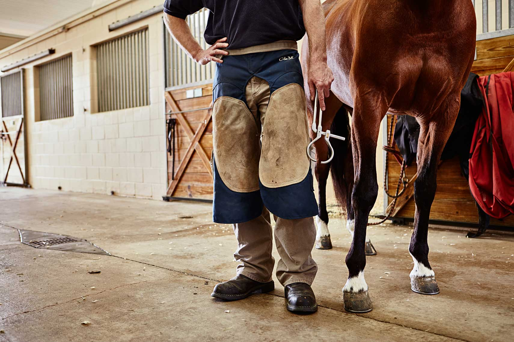 Farrier with horse in stables by Nick Burchell, Atlanta lifestyle photographer