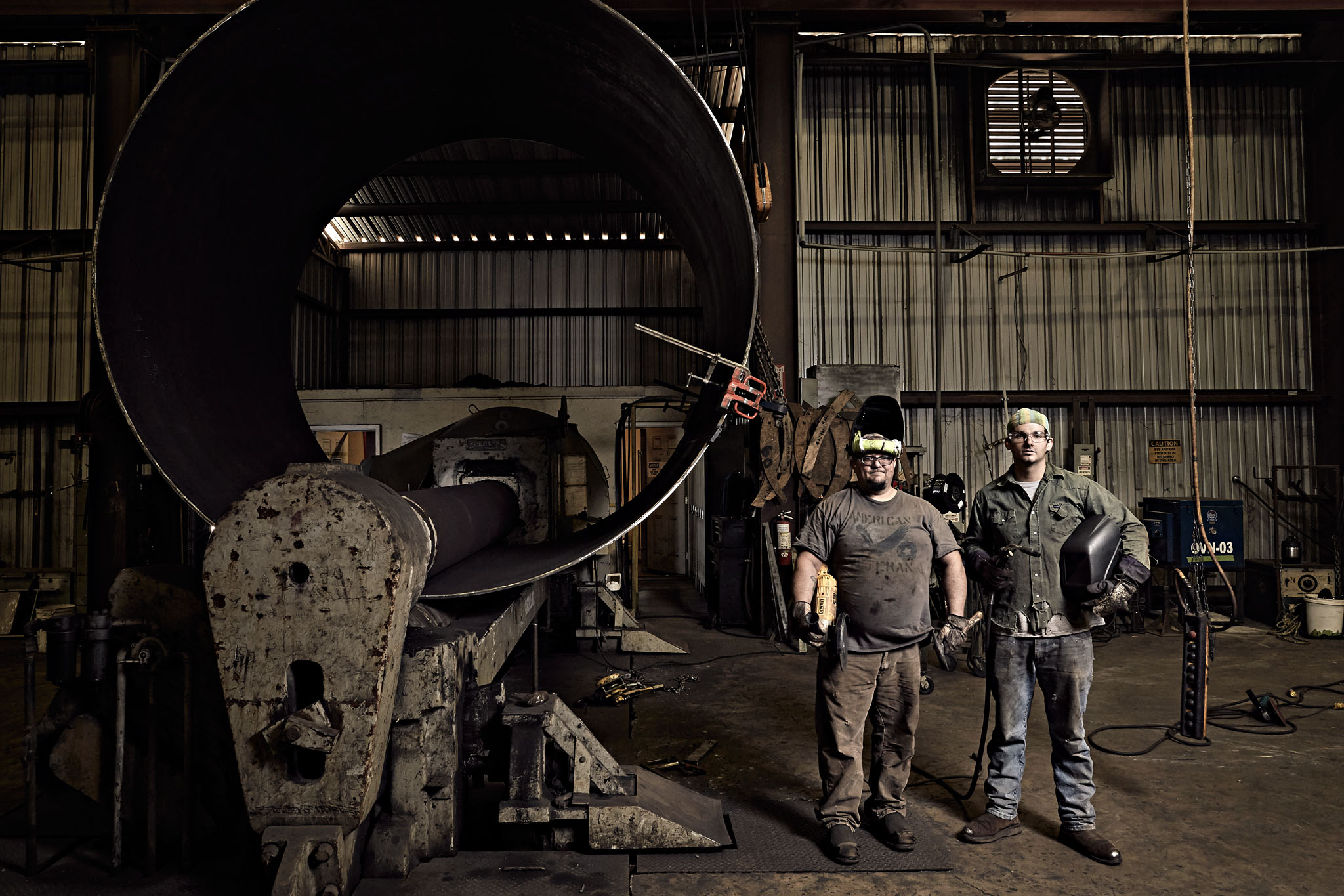 Two welders at their machines, factory. Nick Burchell industrial photographer
