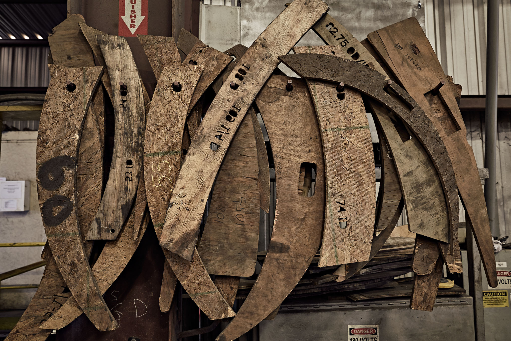 Stamp and welding forms at industrial factory by Atlanta photographer Nick Burchell