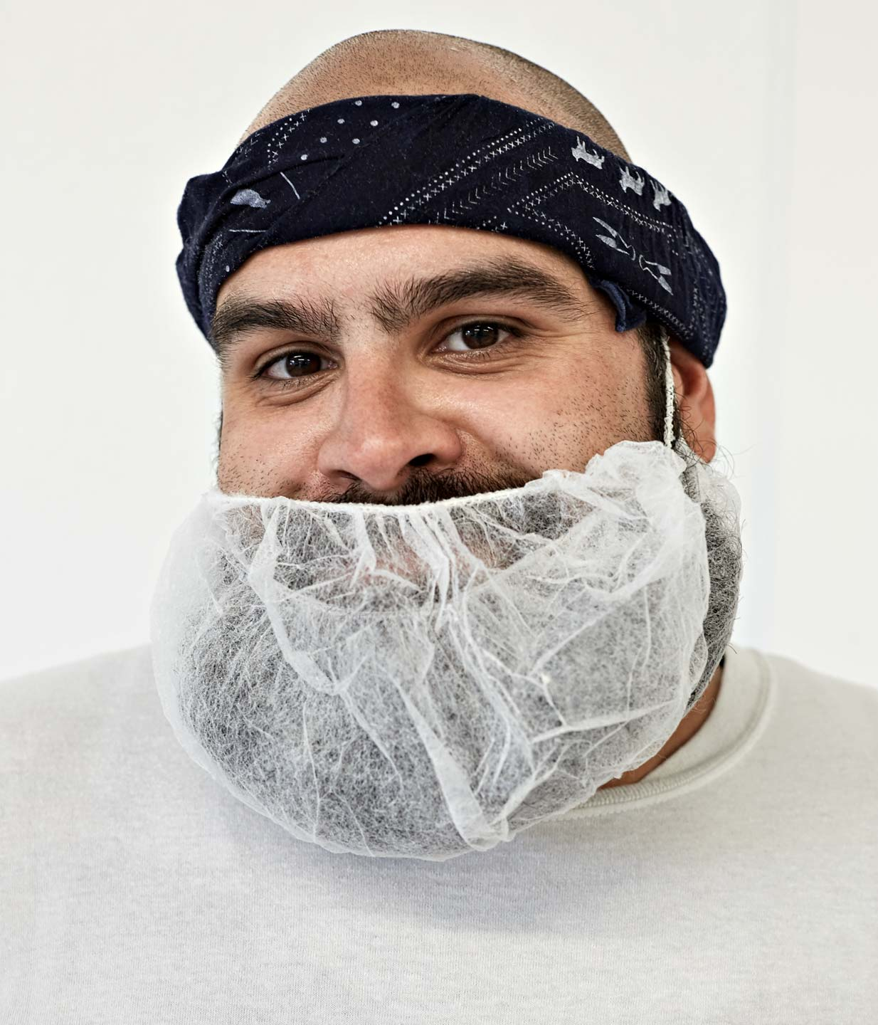 Portrait of food worker with beard net by Atlanta Photographer Nick Burchell