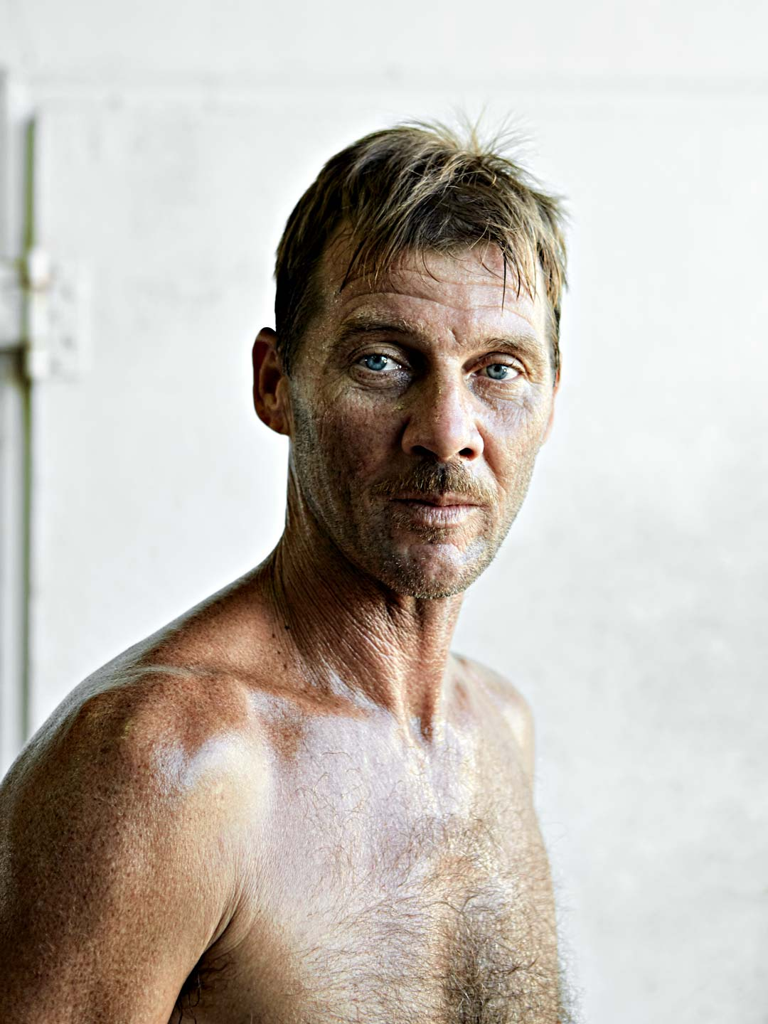 Portrait of shirtless fisherman. Nick Burchell Atlanta portrait photographer