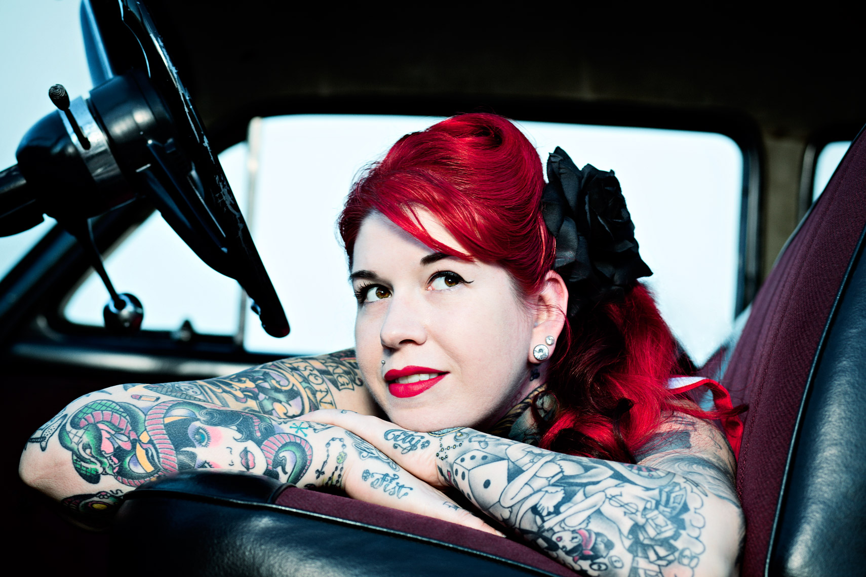 Photograph of heavily tattooed woman in truck, Atlanta